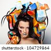 Fashion close-up portrait of beautiful young girl with cubes on head. Conceptual photo. - stock photo