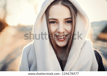 Fashion closeup portrait of young smiling woman