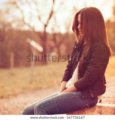 Fashion girl in sunglasses - outdoor portrait with copy space