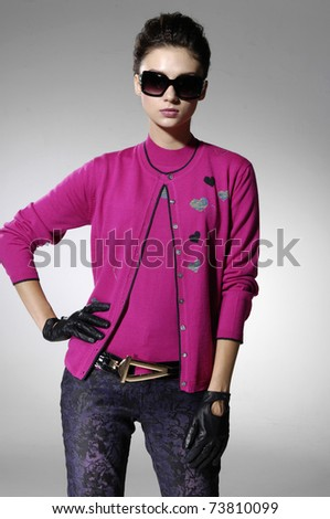 fashion model in fashion sunglasses in light background