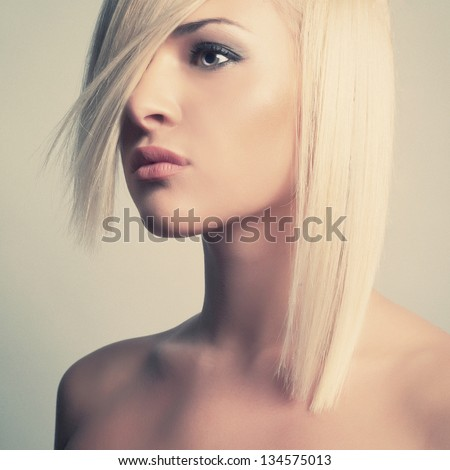 Fashion photo of beautiful sexy blonde with short haircut