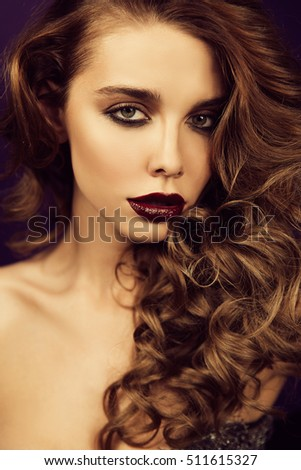 Fashion portrait of a beautiful woman with hair to makeup