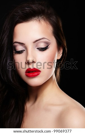 fashion portrait of beautiful brunette girl model with bright makeup red lips. Clean skin. Isolated on black