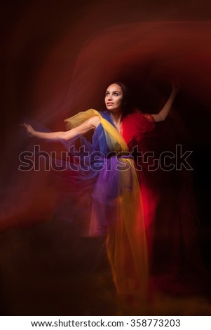 Fashion portrait of beautiful girl in mixed light