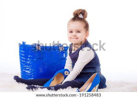fashion portrait. Stylish little girl with shoes and bag mom. isolated on white background.   shopping