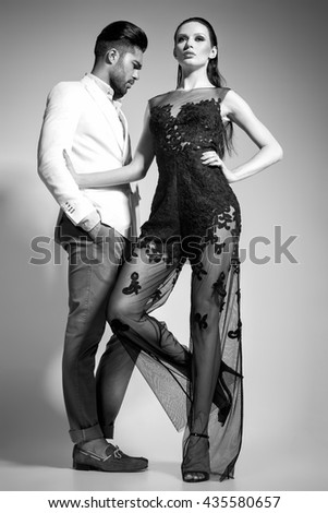 fashion sexy couple dressed elegant posing in the studio - bw