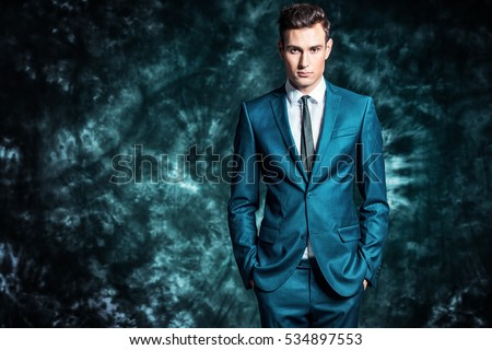 Fashion shot of a handsome young man in elegant classic suit. Men's beauty, fashion.