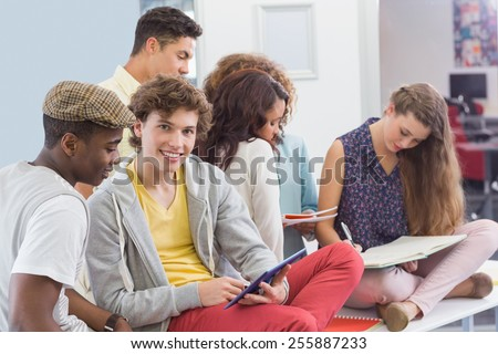 Fashion students reading their notes at the college
