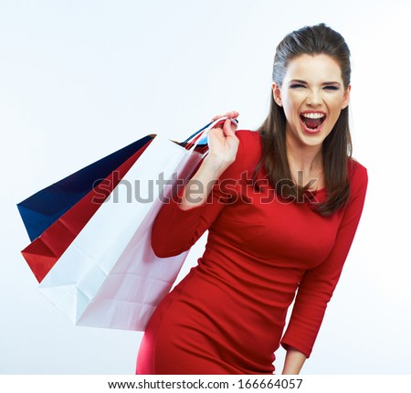 Fashion woman portrait isolated. White background. Happy girl hold shopping bag. Red dress. female beautiful model.