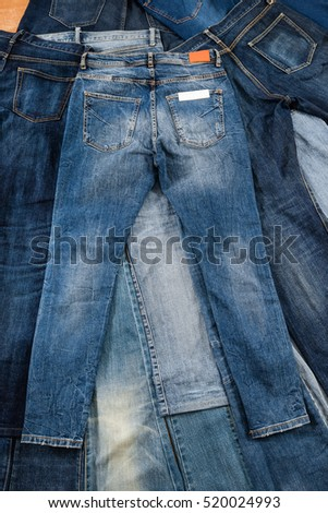 fashionable clothes, pile of jeans
