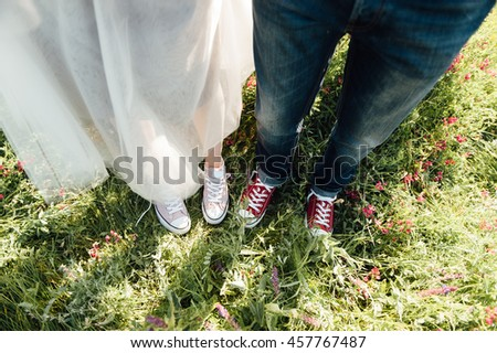 Fashionable cool couple, legs, lifestyle - concept. have fun on grass