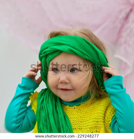 Fashionable girl in a green cap