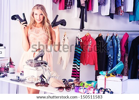 Fashionable girl shopping in a store.
