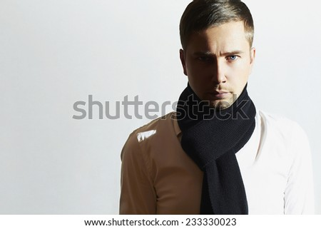 Fashionable Handsome Young Man in scarf. Stylish Boy. Casual Winter Fashion