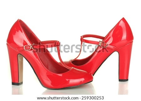 Fashionable red woman shoes isolated on white background