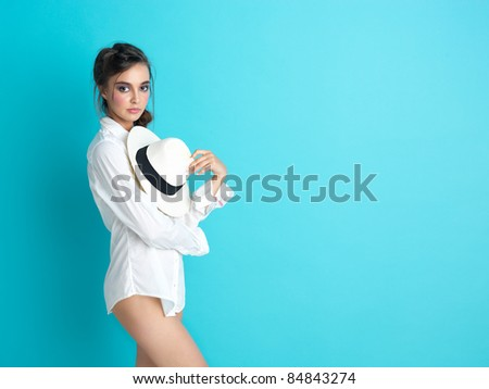 fashionable woman white shirt hat blue background