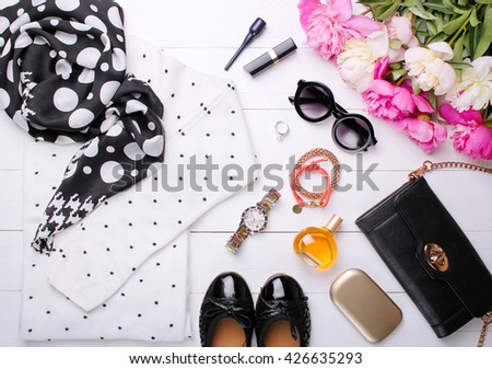 fashionable women's clothes on a white background