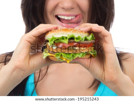 Fast food concept. Tasty unhealthy burger sandwich in hands hungry mouth getting ready to eat isolated on a white background