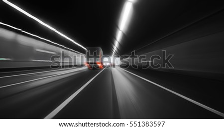 Fast movement through a motorway tunnel on a monochrome background