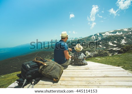 Father and his little son near the Seven lakes in Rila mountain, Bulgaria, Sitting and looking to the mountains.