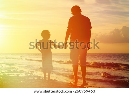Image result for dad holding son's hand on beach