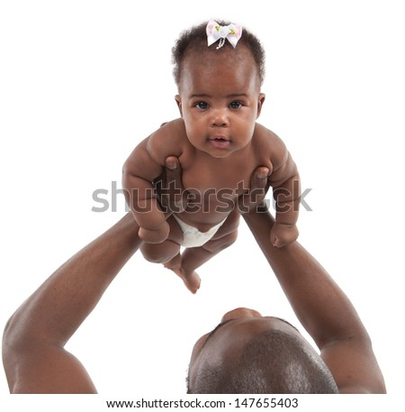 Father holding up 3-month old smiling baby girl  on white background
