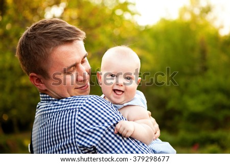father hugging his son