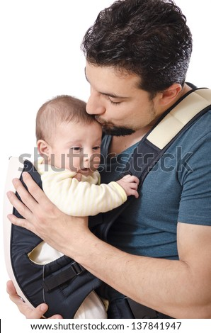 Father kissing little baby