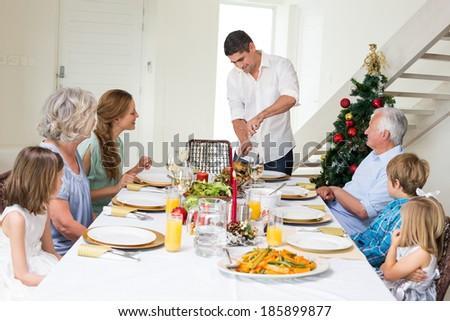 Smiling woman serving family dinner tet stock photo for Restaurants serving christmas dinner