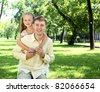 Father with daugther outside in the summer park - stock photo