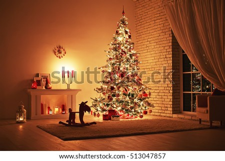 Feast of the Nativity. Beautifully decorated house with a tree and presents at Christmas