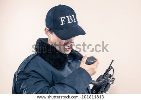 Federal Investigations mustache agent in coat yelling with baseball cap over eyes on vintage radio during crises