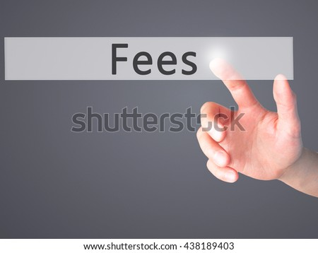 Fees - Hand pressing a button on blurred background concept . Business, technology, internet concept. Stock Photo