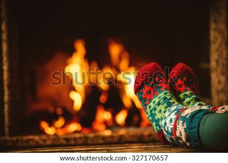Feet Woollen Socks By Christmas Fireplace Stock Photo 223147579