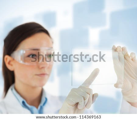 Femal lab technician selecting blank pane from hologram