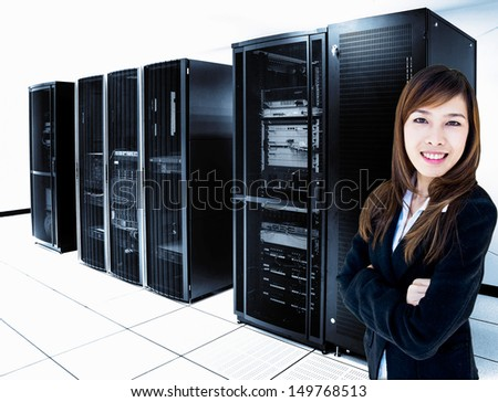 female administrator standing in server room