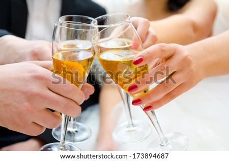 female and male hands with glasses of champagne
