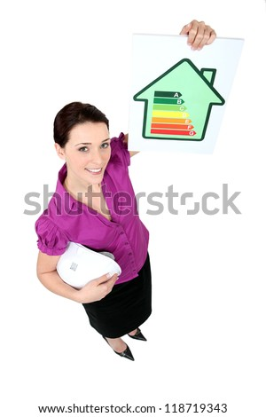 Female architect holding energy rating card