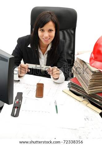 Female architect with house plans in her office