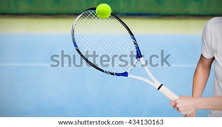 Female athlete playing tennis against close up view of tennis court