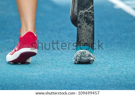 female athlete with handicap prepares for long jump