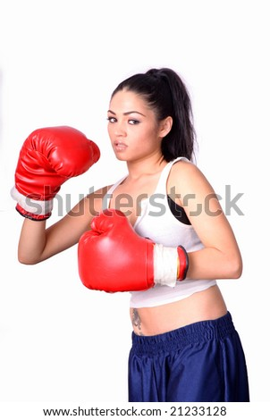 female boxer in offensive position isolated over white background