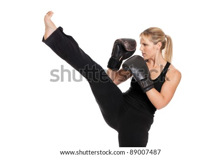 Female boxer punching isolated on a white background