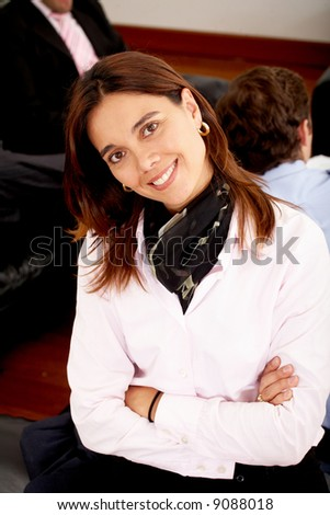 female business executive in an office smiling