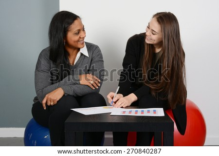 Female Business Team of Mixed Races at Office