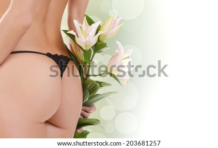 Female buttocks with a lily