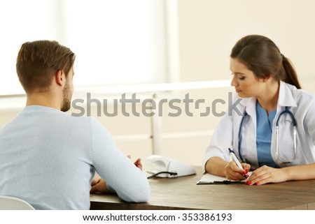 Female doctor examining patient blood pressure