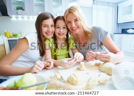 Female family smiling at kitchen table