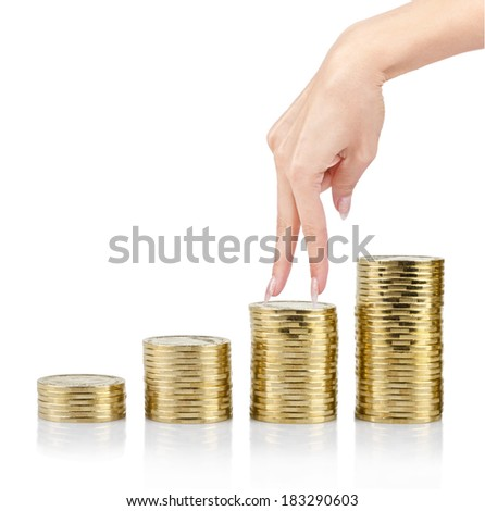 female fingers on the columns of coins