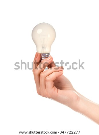 Female hand holding a light bulb, isolated on a white background